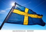 stock-photo-sweden-flag-on-dark-blue-sky-background-66350500